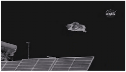 The video that accompanies the article shows SuitSat1 spinning away from the ISS.